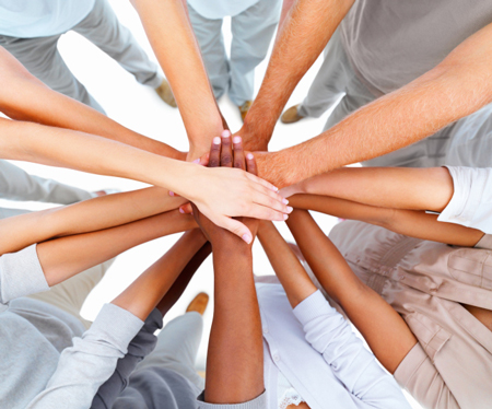 Multi-Ethnic hands on top of each other in a circle