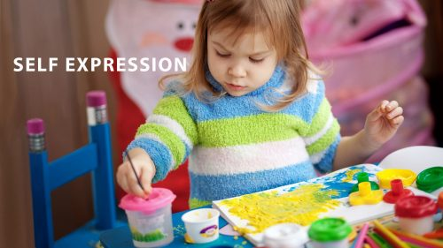 Little Girl Expressing Herself Through Painting