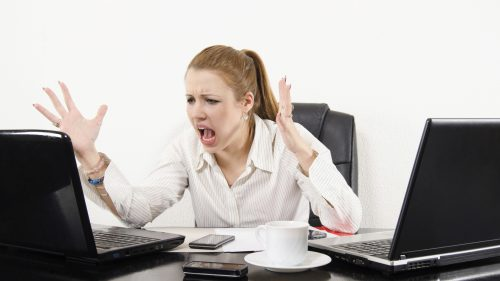Frustrated Woman Having Difficulty Coping with Modern Stress